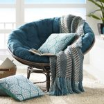 Unique reading chair rounded reading chair blue-rounded reading chair cozy rounded reading chair comfortable rounded reading chair comfy rounded reading chair white furry rug blue knitted blanket blue decorative pillows rounded wood