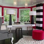 alluring pink home office design with white accent and cozy black and white giant chair with large glass window in laminate flooring