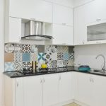 amazing apartment kitchen with ravishing white kitchen island also enchanting glossy countertop with colorful backsplash in laminate flooring