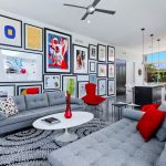 amazing artistic living room design with multiple art wall feat sexy bold red cushion with gray sofa in concrete flooring idea