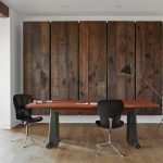 astonishing workingspace idea with gorgeous wooden stripes panel also large wooden table with eccentric arch lamp in hardwooden flooring