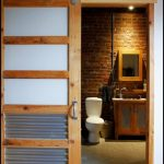 bathroom barn doors in rustic white modern closet wood-framed mirror mini cabinet with sink and faucet