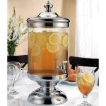 beautiful and luxurious glass beverage dispenser with stainless steel stand and spigot