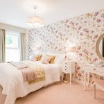 beautiful feminine bedroom with amazing flower wallpaper also interesting small bedding idea with beautiful round mirror in soft peach large carpeting