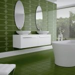 beautiful green tiles for bathroom floor green bathroom wall with white floral patterns twin oval ornamental mirrors twin sinks twin stainless steel faucets elegant white tub big frameless glass window