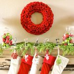 beautiful red roses wreath red and green Christmas balls within transparent glass food containers fresh and green leaves decoration  red-white socks Christmas ornaments