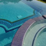 beautiful swimming pool with blue tile for the border of round pool white tile for the bottom black and blue decorative tile for the bottom decoration of the pool