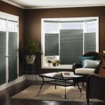 black blinds for windows dark rattan chairs dark wood platform table with tiny metal feet table lamp in classic style live and fresh floral decorations darkwood finish flooring