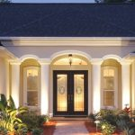 black painted door frame creame painted exterior wall gray roofing perfect exterior lighting ideas beautiful front entry beautiful front yard stoned walkways