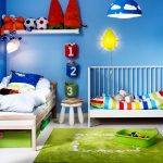 Blue Painted Wall Green Cozy Floor Rug Wooden Bedframe White Painted Crib White Painted Storage Cute Decorations For Kids Room Colorful Striped Bedspread Soccer Themed Kids' Room For Boy