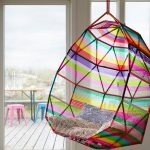colorful web hanging chair with ethnic pattern ornamental pillows