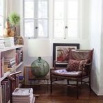 cozy reading area with cozy leather chairs and elegant white bookshelves with interesting white window in hardwooden flooring