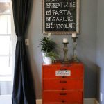 creatie list menu on framed chalkboard oldish-style of cabinet unit decorative candle standings decorative floral pots