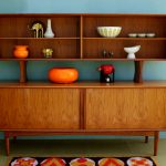 distinctive sideboard design with top shelves unique pattern carpet bright orange ornament items gold elephant miniature  decorative bowl ornaments in different size