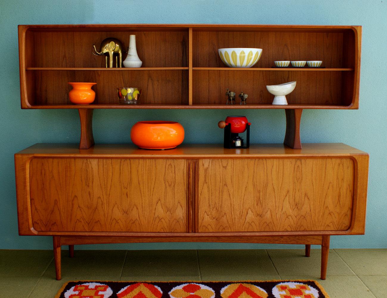 Distinctive Sideboard Design With Top Shelves Unique Pattern Carpet Bright Orange Ornament Items Gold Elephant Miniature