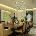 elegant dining room concept with refreshing green accent with potted vegetation on the table with luxurious crystak chandelier with granite tile base