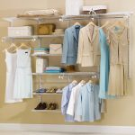 elegant shelving units with steel hanging kits units several hanged clothes piles of folded clothes a pile of blankets white boxes beautiful handy bags several pairs of shoes