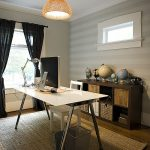 elegant workingspace design with ravishing white glossy table top also interesting subtle stripes wall with eclectic cabinet also ethnic rug in laminate flooring