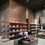enchanting store concept with black wavy wooden ceiling also magnificent wooden wall patterned with floating shelves for display in laminate flooring
