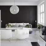 exciting black and white living room with unique round pendant lamp also cozy white sifa in white tile flooring