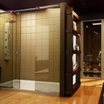 framed-big glass windows glossy wood flooring extra-large wall-shelving full-height glass shower space light brown subway tiles walls dark wood countertop with white porcelain basin faucet in stainless steel