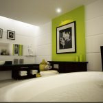 fresh green and white bathroom idea with large round bathtub also ravisihing black vanitits with wallmount mirrors and elegant painting in granite tile flooring