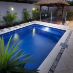 glass pool fencing a simple gazebo twin decorative lightings mini garden marble tiles floors with natural stones decoration