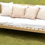 hardwood daybed with higher sides and white mattress plus pillows