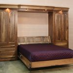 hardwood folding bed with bright purple mattress and two big cupboards