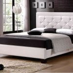 high-class white king headboard unit elegant black bedcover black and white pillows flower-shape white standing lamp with stainless steel stand