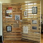 horizontal wood  plaques room divider with several picture frames and announcement papers