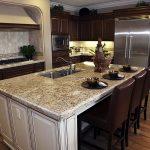 Huge Stainless Steel Door Refrigerator Grey Granite Countertop With Leather Seating And Storage Hardwood Planks Floor