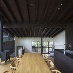 interesting black kitchen design with elegant wooden dining furniture set with ravishing clusters ceiling in laminate flooring