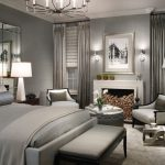 interesting grey bedroom concept with sleek furniture and luxurious chandelier also cozy chairs with warm fire place in large white rug