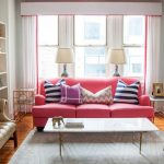 interesting living room deasign with cute pink sofa and stripses blue and white cushion and elegant brown leather sofa with marble coffee table in laminate flooring