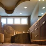 interesting spa-ispired bathroom with elegant dark brown accent and wonderful curwy ceiling with multiple down light in granite tile flooring