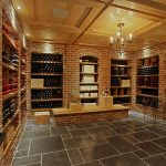 interesting wine celar design with wooden ceiling concept feat ravishing wall brick patterened with elegant soft cream accent in gray concrete flooring