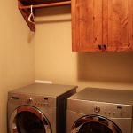 laundry room hardwood single cabinet single wood shelf with single wood hanging kit unit a hanger two units of laundry machines