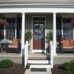 light gray painted house exterior wooden exterior door small front porch front porch decorating ideas black painted rattan armchairs red cushions beautiful house exterior