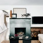newest fireplace design in grey comfortable grey daybed TV desk with wood logs ornaments TV set  twin black round table