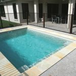 plunge pool with metal pool fences