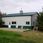 pole barn home design with a single door some windows and metal siding roof  and walls