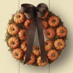 pumpkin wreath ornament with brown ribbon accessory