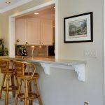 Rattan Stools White Wall Downlights White Ceiling Grey Marmer Counter White Cabinet White Upper Cupboard White Framed Kitchen Pass Trhough White Tiled Flooring