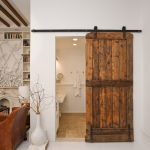 rustic style sliding barn door in bathroom white ornamental porcelain vase with decorative plant