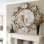 sheffield home mirror in bronze frame black elegant vase with beautiful lily flowers mini metal kangoroo statue luxurious-shape table lamp classic console abstract painting with brown wood frame fireplace unit