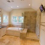 shower no door with a frameless glass platform a large bathtub cream ceramic tiles floor