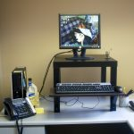 simple black desk stand computer set and its keyboard cable telephone set
