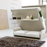 simple white folding bed with shelf and  white sofa  under bed fury carpet in grey color