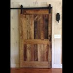 sliding style wood barn door for bathroom candle lighting on the wall